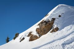Rocks covered by pristine powder snow in mountains stock image