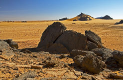 Rocks in desert landscape. Sand and rocks Acacus Mountains landscape in desert of western Libya Stock Photo