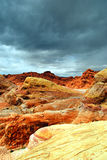 Rocks in desert with stormy sky. The red rocks of the Nevada desert under a threatening sky.  White Domes area, Valley of Fire Stock Image