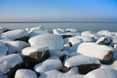 Rocks of Dutch breakwater in wintertime Royalty Free Stock Images