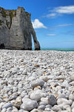 Rocks from Etretat. Image of the rocky beach and iconic natural arch from Etretat in Upper Normandy in North of France. Selective focus on the rocks in the first Royalty Free Stock Photo