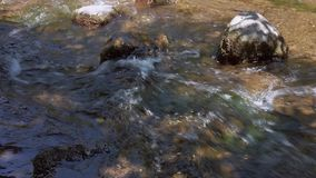 Rocks In A Fast Flowing River. Big Rocks In A Fast Flowing River With Shadows of Trees stock video footage