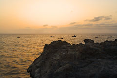 Rocks and fisherboats at sunset, Las Puntas, El Hi Royalty Free Stock Photography
