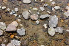Rocks in a river bed. Rocks in a flowing river bed, background Stock Photos