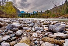 Rocks in the flowing river Stock Photos