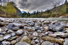 Rocks in the flowing river Royalty Free Stock Image