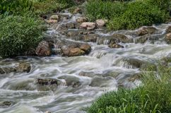 Rocks and flowing river water. San Antonio river flows over rocks in Espada Park, San Antonio, Texas Stock Image