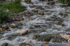 Rocks and flowing river water. San Antonio river flows over rocks in Espada Park, San Antonio, Texas Royalty Free Stock Photography