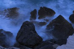 Rocks in flowing water at autumn evening in Adriatic Sea Croatia Stock Photography