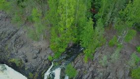 Rocks and flowing water at Kivach fall in Karelia. Aerial shot stock video