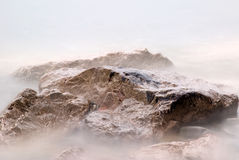 Rocks and fog. Isolated  rocks into the fog Stock Image
