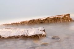 Rocks and fog. Rocks into a white fog Stock Image