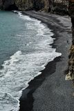 Rocks formation on Dyrholaey cape with black sand beach. Near Vik town, Iceland in summer on sunny day stock photos