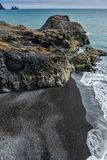 Rocks formation on Dyrholaey cape with black sand beach Stock Photos
