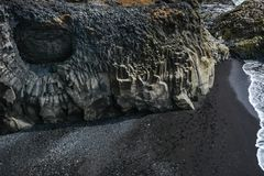 Rocks formation on Dyrholaey cape with black sand beach. Near Vik town, Iceland in summer on sunny day stock photography