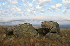Rocks formations in Dobrogea, Tulcea county, Romania. Naturally formed piles of large rocks in Macin Mountain the olders alps in E. Urope stock images