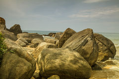 Rocks in front of the shining turquoise-blue Indian Ocean Royalty Free Stock Image