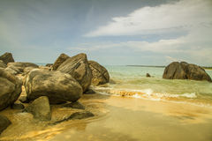 Rocks in front of the shining turquoise-blue Indian Ocean Royalty Free Stock Photo