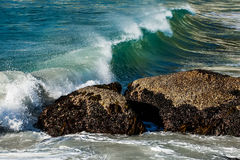 Rocks in front of a wave Stock Image