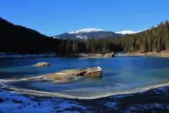 Rocks in frozen lake Cauma Royalty Free Stock Photography