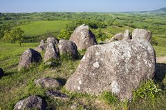 Rocks on green hilltop. Under blue sky in Minamioguni, Kumamoto Stock Image