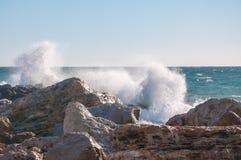 Rocks, horizon and crashing wave. Waves crashing on rocky shores in a winter storm outside Palma de Mallorca Stock Image