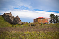Rocks and House in East Iceland Stock Photography