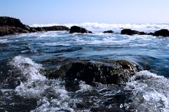 Rocks In Waves Royalty Free Stock Photos