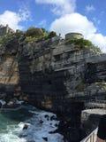 Rocks in Italian sea, castle Stock Image