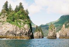 Rocks Jutting out of Ocean near Seward Alaska Stock Image
