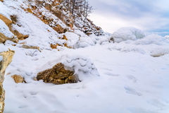 Rocks in Lake Baikal covered with ice and snow Royalty Free Stock Image