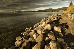 Rocks at the lakeside Stock Photo
