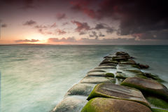 Rocks leading to sea Stock Photography