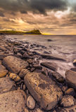 Rocks and ledges of Kimmeridge Bay at sunset Royalty Free Stock Image