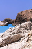 Rocks of Lefkada, Greece - Kavalikefta. Rocks of Lefkada, Greece. This is Kavali Kefta's beach. The rocks are wet from the water clear and blue. The water is Royalty Free Stock Image