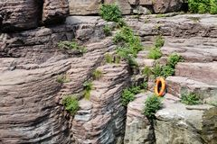 Rocks and Lifebuoy Royalty Free Stock Photography