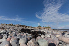 Rocks and lighthouse Royalty Free Stock Photos