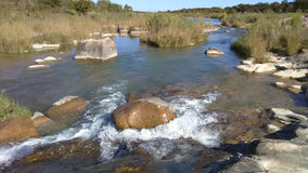 Rocks on the Llano River near Castell, Texas. Llano River between Mason and Castell.rn11/20/2016rnKarla Held Stock Image