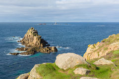 Rocks and longships lighthouse Lands End Cornwall England UK Stock Photography