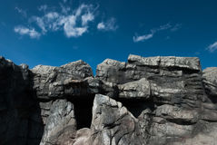 Rocks material. Rock and blue sky with some clouds in national park Royalty Free Stock Image