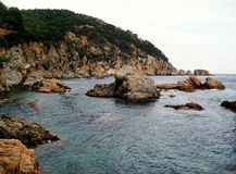 Rocks and Mediterranean Sea as wild spanish nature. This shot was taken with Nikon D3100 at the coast Costa Brava in Tossa de Mar (Catalonia, Spain Stock Photo