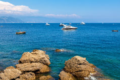 Rocks and Mediterranean sea in Portofino. Royalty Free Stock Photos