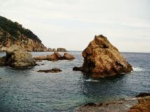 Rocks in the Mediterranean sea in Tossa de Mar, Costa Brava, Spain as a stunning landscape Stock Photography