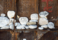 Rocks with messages. White rocks with written messages inside the shipwreck in Navagio beach at island Zakynthos, Greece royalty free stock photo