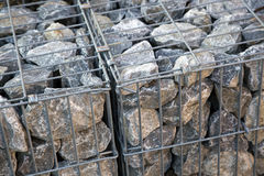 Rocks in a metal cage Royalty Free Stock Photos