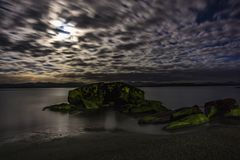 Rocks in the midnight moon light Royalty Free Stock Photo