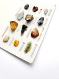 Rocks minerals collection hobby. An image showing an antique rock collection of assorted minerals.  Displayed on white cardboard and labelled, colorful rock Royalty Free Stock Image