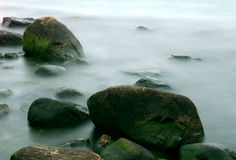 Rocks in Mist. Rocks on shoreline in water and mist stock images