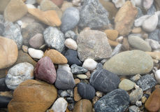 Rocks in mist. Colorful rocks and pebbles in mist Royalty Free Stock Image