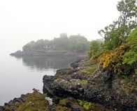 Rocks and misty scottish castle Royalty Free Stock Photography